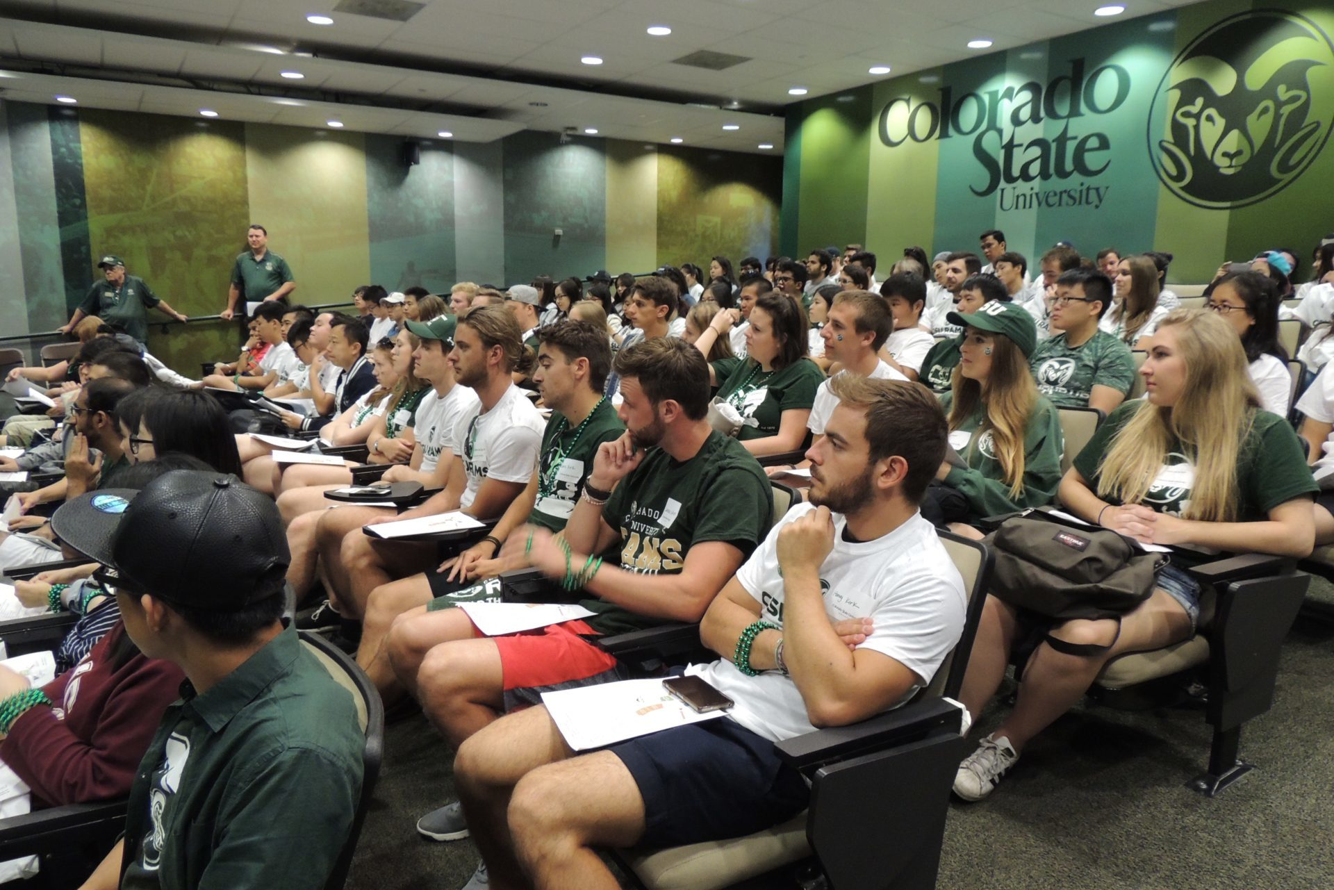 group of students listening to a lecture about football