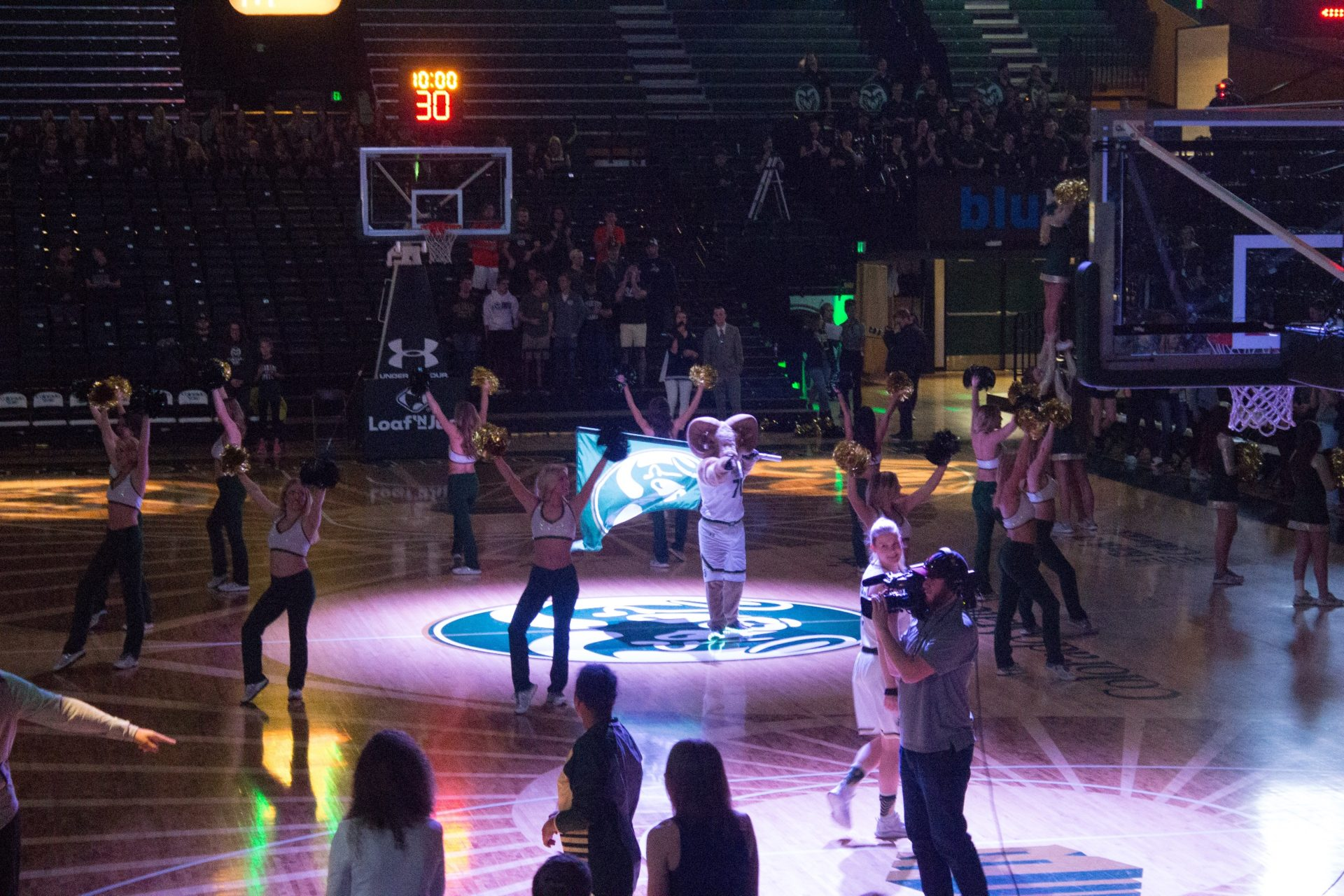 ram mascot at center of a basketball court with cheerleaders