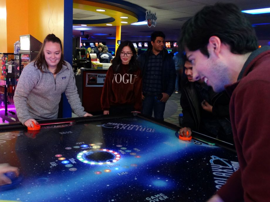 students playing in an arcade