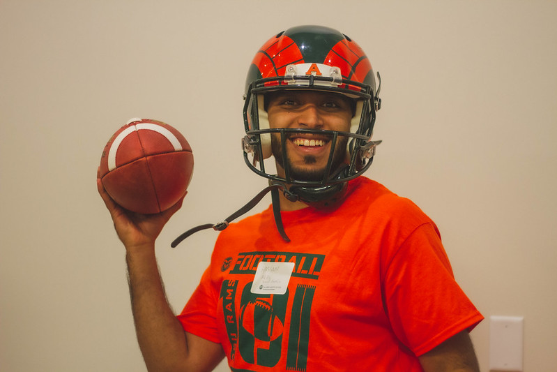 man in a football helmet and holding a football