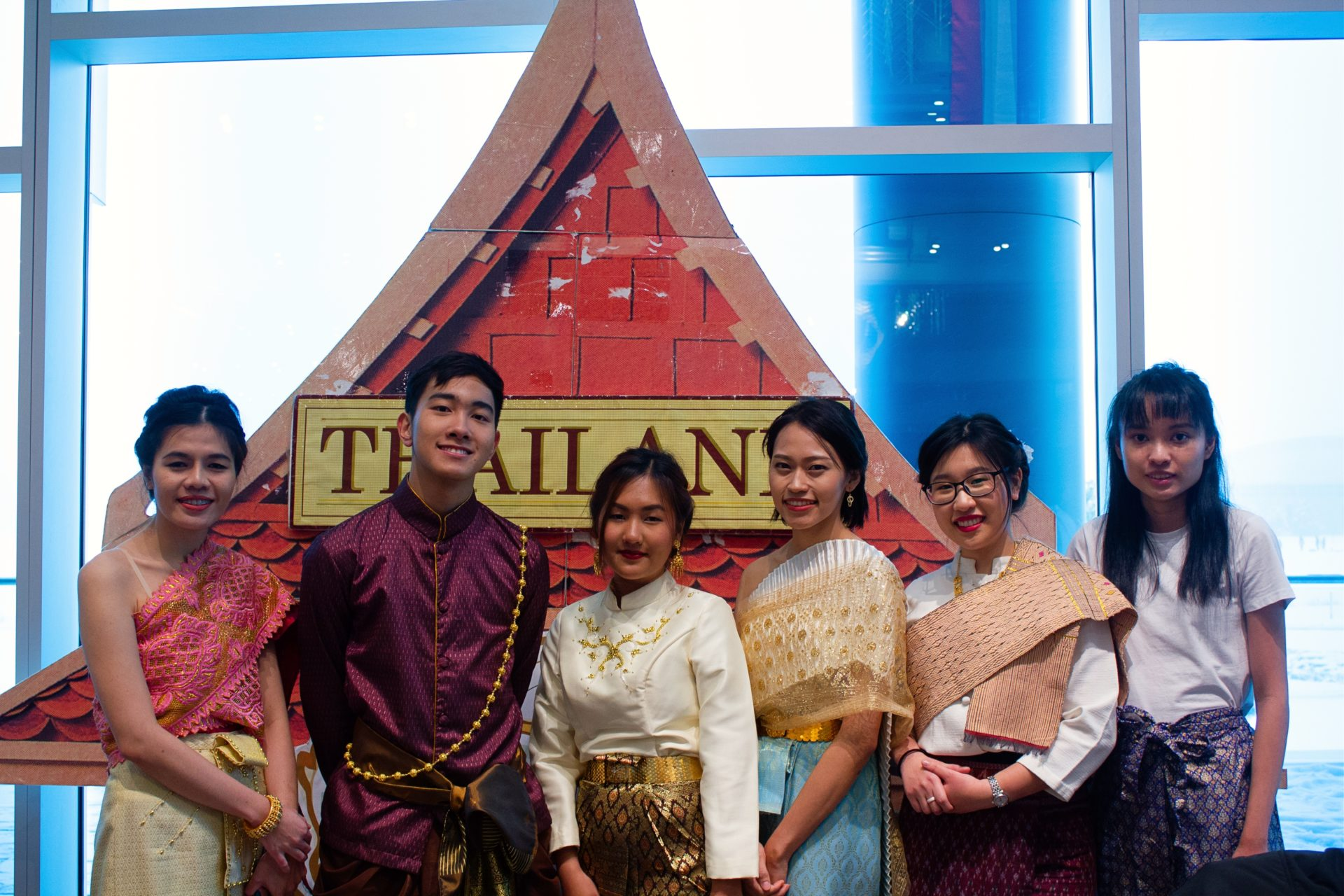 students in front of a Thai structure