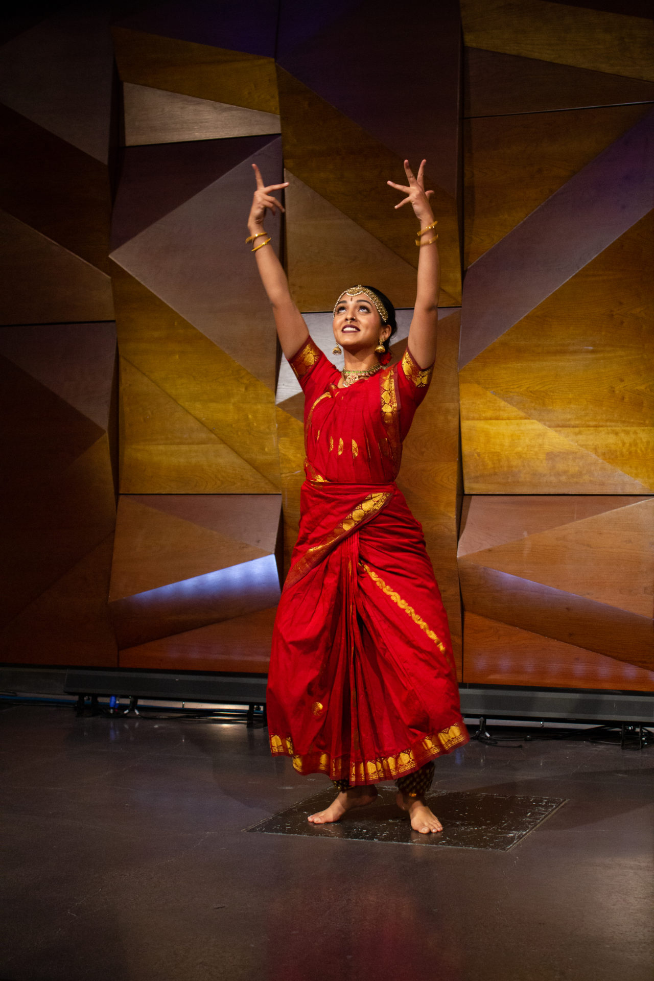 one indian dancer in red outfit