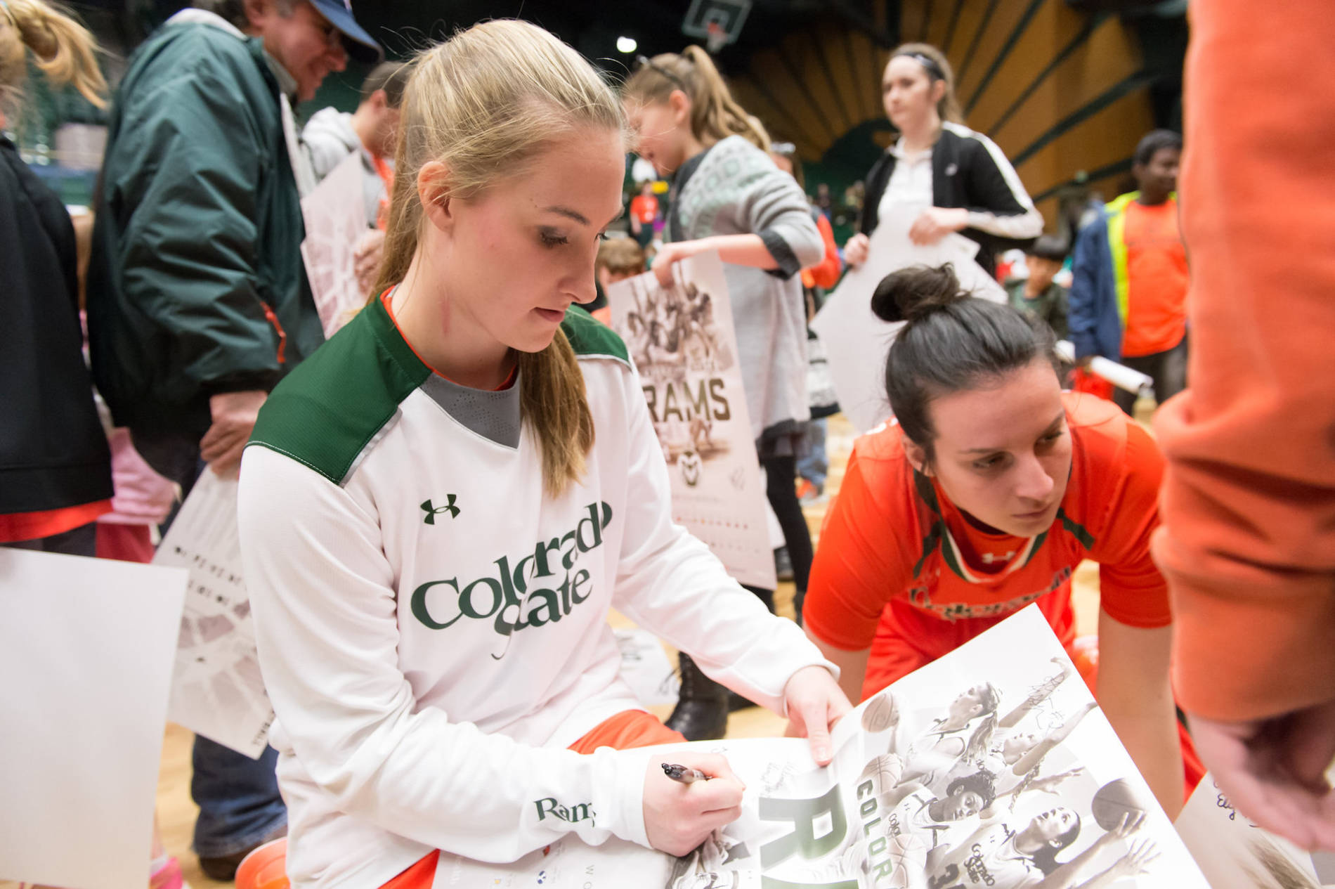 players signing posters